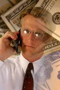 Money Floating Around Businessman on Cell Phone